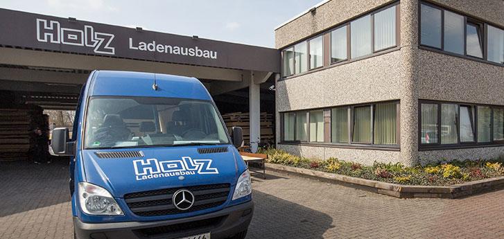 https://www.holz-ladenausbau.de/uploads/images/slideshow/header/aussenansicht-standort-moorrege.jpg